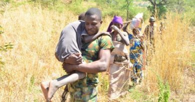 Nigerian soldier leads victims rescued from Boko Haram captivity on Nov. 16 2019